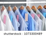 rack with clean clothes on... | Shutterstock . vector #1073300489