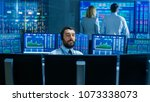 stock exchange trader makes a... | Shutterstock . vector #1073338073