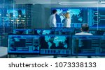 in the system monitoring room... | Shutterstock . vector #1073338133