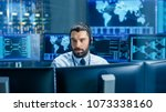 in the system monitoring room... | Shutterstock . vector #1073338160