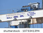 Small photo of Greer,SC/USA-April 20 2018: A spreader crane at Inland Port Greer, a rail head about 212 miles inland from the Port of Charleston SC, is shown. The facility is run by South Carolina Ports Authority.
