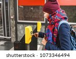 Small photo of Woman validate ticket in validating machine device to entering at metro station in Prague