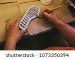experienced footwear industry... | Shutterstock . vector #1073350394