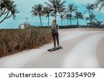 young girl on the skateboard... | Shutterstock . vector #1073354909