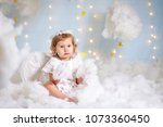 The Baby As The Angel Soaring...