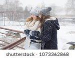 two girls walk on a snowy day | Shutterstock . vector #1073362868
