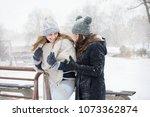 two girls walk on a snowy day | Shutterstock . vector #1073362874