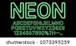 neon font in green color.... | Shutterstock .eps vector #1073395259