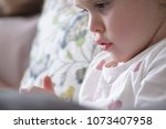 child reading a storybook... | Shutterstock . vector #1073407958