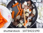chef putting slicr of carrot... | Shutterstock . vector #1073422190