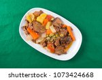 pork tongue stew on the plate   ... | Shutterstock . vector #1073424668