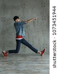 teenage boy in jeans and red... | Shutterstock . vector #1073451944
