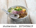 assam laksa  noddle in tangy... | Shutterstock . vector #1073458619