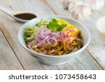 assam laksa  noddle in tangy... | Shutterstock . vector #1073458643