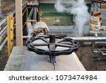 valve open and close of steam... | Shutterstock . vector #1073474984