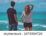 couple looking at a tropical... | Shutterstock . vector #1073504720