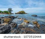 rock and lighthouse in national ... | Shutterstock . vector #1073510444