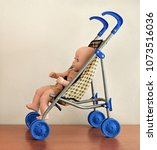 simple doll buggy on wooden...   Shutterstock . vector #1073516036