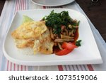 fried egg and vegetables with... | Shutterstock . vector #1073519006