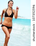 young attractive woman jogging... | Shutterstock . vector #107352596