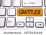 Small photo of Text sign showing Gratitude. Conceptual photo Quality of being thankful Appreciation Thankfulness Acknowledge written on Orange Key Button on White Keyboard with copy space. Top view.