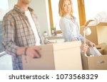 couple unpacking cardboard... | Shutterstock . vector #1073568329