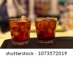 close up on cocktail glasses on ... | Shutterstock . vector #1073572019