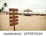 wooden pointer post with copy... | Shutterstock . vector #1073574134