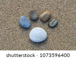 five pebbles in the shape of a... | Shutterstock . vector #1073596400