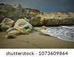 beautiful beach with rock... | Shutterstock . vector #1073609864