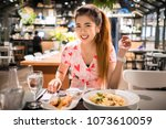 young asian woman eating thai... | Shutterstock . vector #1073610059