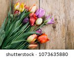 multicolored tulips on a wooden ... | Shutterstock . vector #1073635880