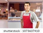 smiling ice cream car employee...   Shutterstock . vector #1073637410