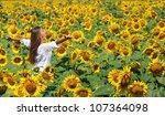 beautiful girl on the field of... | Shutterstock . vector #107364098