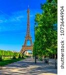 paris eiffel tower and champ de ... | Shutterstock . vector #1073644904