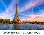 paris eiffel tower and river... | Shutterstock . vector #1073644928