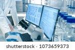 senior female scientist... | Shutterstock . vector #1073659373