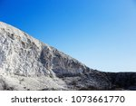 large chalky mountain and blue... | Shutterstock . vector #1073661770