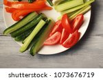 white plate with vegetables for ... | Shutterstock . vector #1073676719