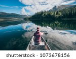 a girl is canoeing in a... | Shutterstock . vector #1073678156