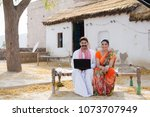 a rural couple sitting on the...   Shutterstock . vector #1073707949