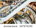 people in motion in escalators... | Shutterstock . vector #107374190