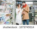 young woman pharmacist choosing ...   Shutterstock . vector #1073745014