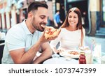dating in pizzeria. young... | Shutterstock . vector #1073747399