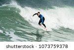 Man Surfing Wave In Winter...