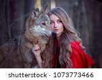 girl with a wolf in a red cloak | Shutterstock . vector #1073773466