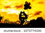silhouette of two beautiful... | Shutterstock . vector #1073774330