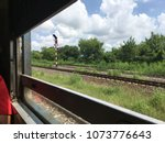 nature outside view in the train | Shutterstock . vector #1073776643