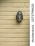 old exterior light affixed to a ... | Shutterstock . vector #1073798420