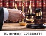 Judge's Hand Striking Mallet On ...